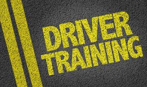 Driver training painted on road in yellow