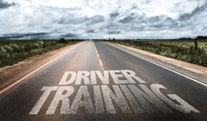 Driver training painted on road